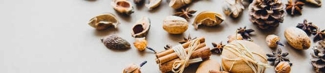 Selection of nuts, spices and cookies, cropped photo by MiroslavaonUnsplash