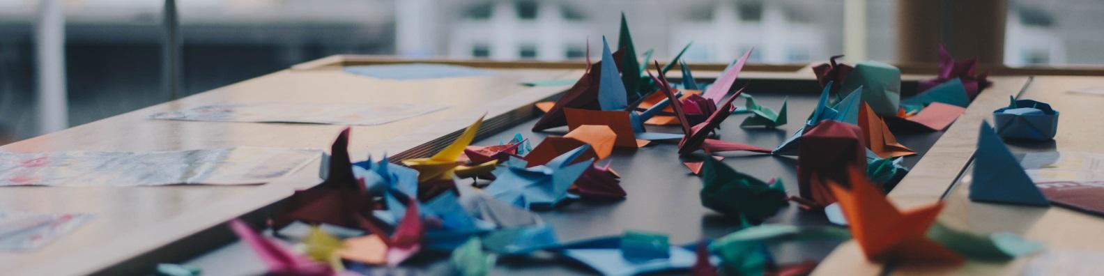 Selection of origami cranes, cropped photo byDevonUnsplash